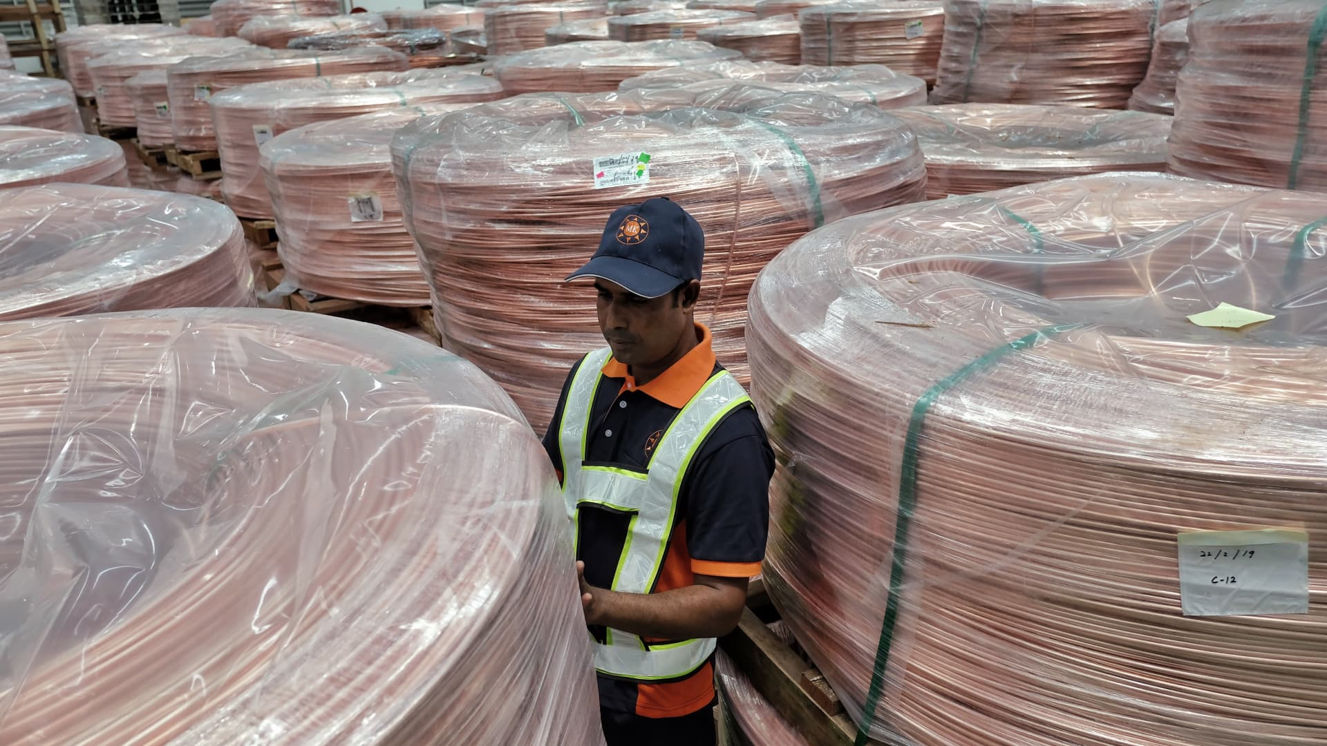 A worker checks the final packing of copper rod during the Metrod official launch for the new plant on Feb. 23, 2019 in Shah Alam, Malaysia.