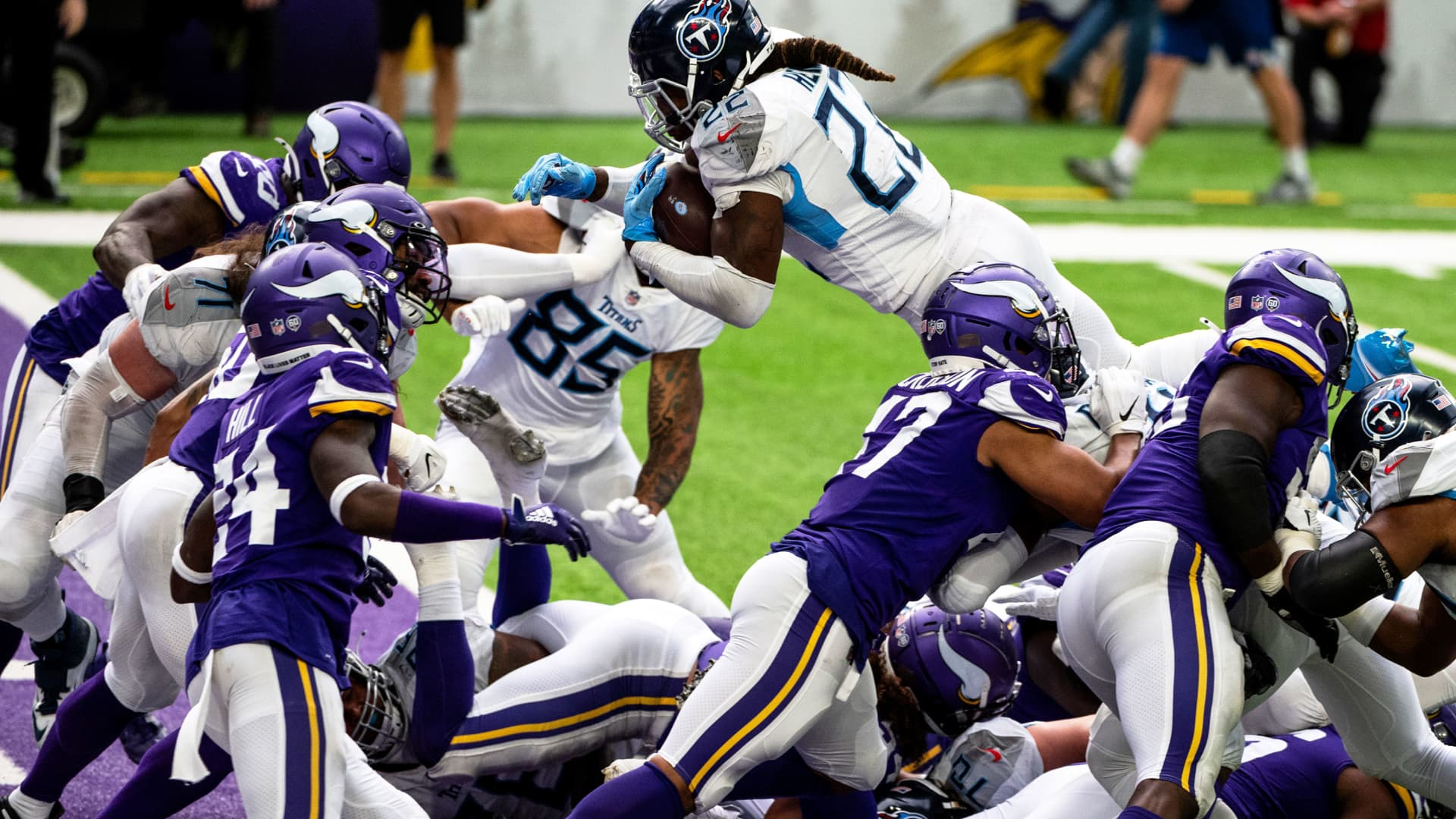 Derrick Henry #22 of the Tennessee Titans dives with the ball into the end zone for a touchdown in the third quarter of the game against the Minnesota Vikings at U.S. Bank Stadium on September 27, 2020 in Minneapolis, Minnesota.