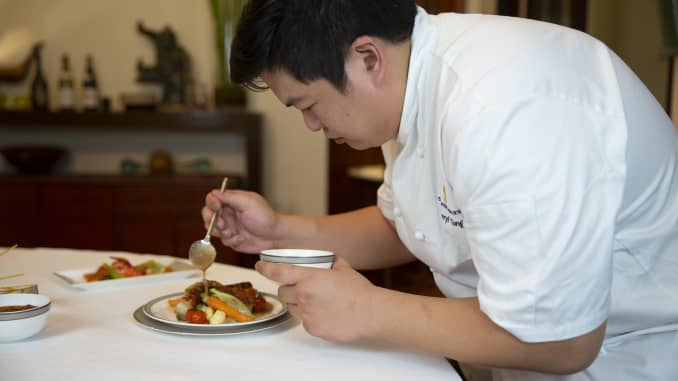 """Through Singapore Airlines' """"Book the Chef"""" service, a private chef will reheat, plate and serve a first-class or business-class meal in customers' homes."""