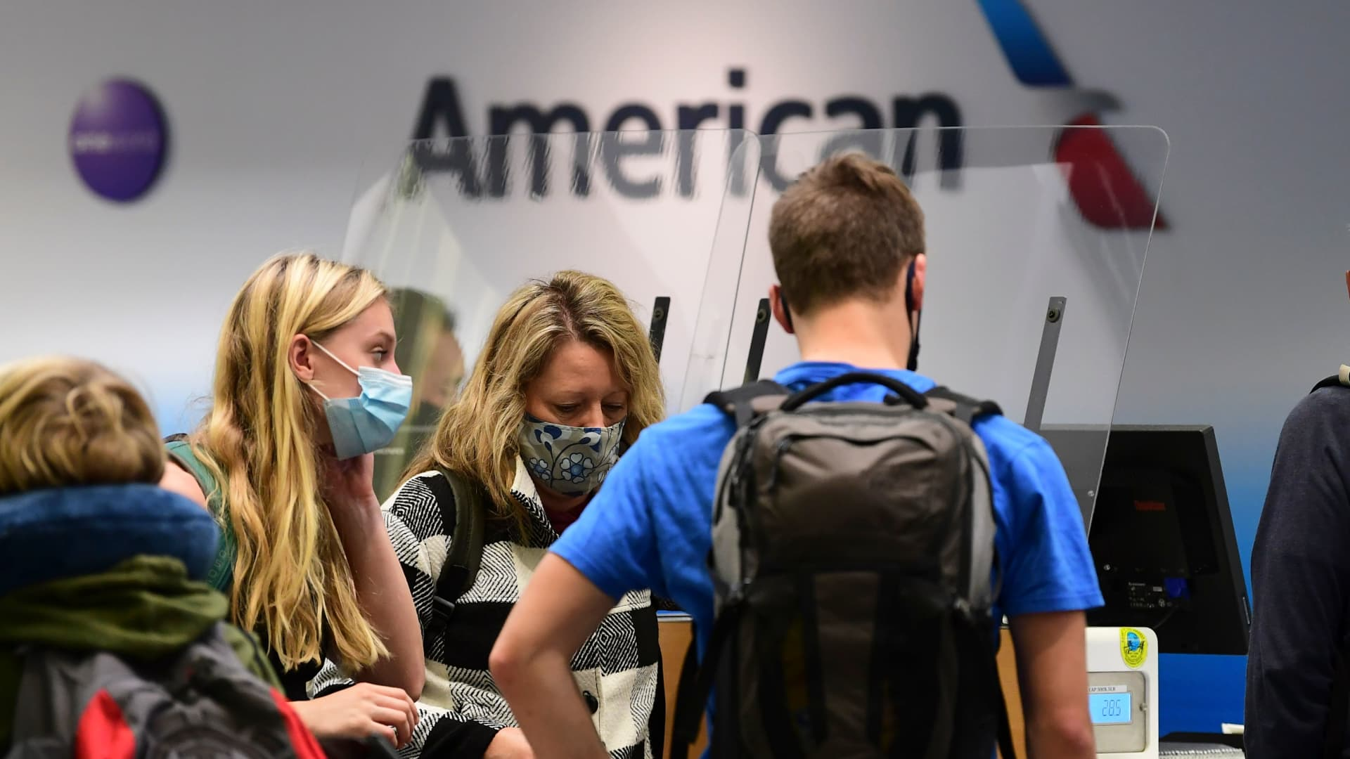 Travelers at the American Airlines check-in counter at Los Angeles International Airport on October 1, 2020.