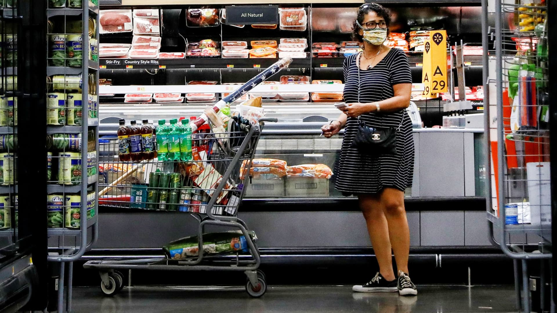 A shopper is seen wearing a mask while shopping at a Walmart store in Bradford, Pennsylvania, July 20, 2020.