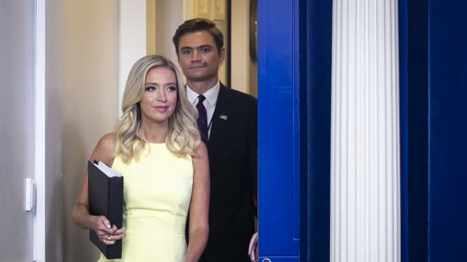 Kayleigh McEnany, White House press secretary, left, and Chad Gilmartin, principal assistant White House press secretary, arrive to a news conference in the James S. Brady Press Briefing Room at the White House in Washington, D.C., U.S. on Thursday, July