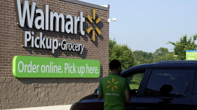 A Wal-Mart Pickup-Grocery employee helps a customer at a test store in Bentonville, Arkansas.