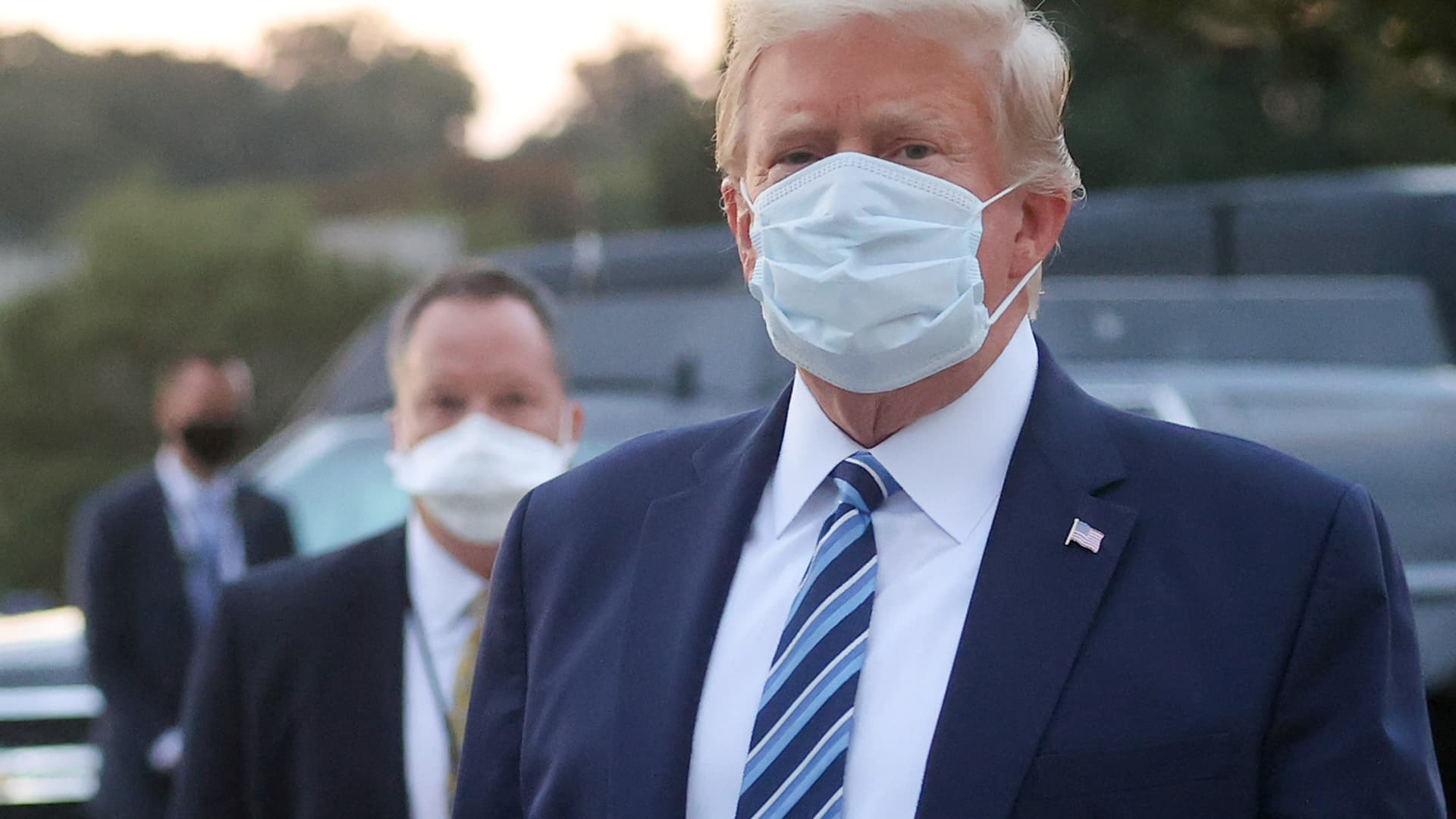 U.S. President Donald Trump looks over at reporters and photographers as the president departs Walter Reed National Military Medical Center after a fourth day of treatment for the coronavirus disease (COVID-19) to return to the White House in Washington from the hospital in Bethesda, Maryland, U.S., October 5, 2020.