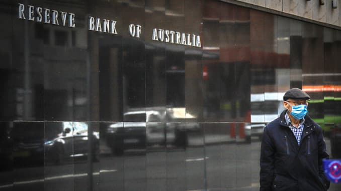 A pedestrian wearing a face mask walks past the Reserve Bank of Australia (RBA) building, during a partial lockdown imposed due to the coronavirus, in Sydney, Australia, on Monday, May 18, 2020.