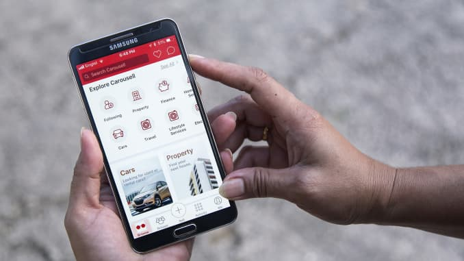 The Carousell application is displayed on a smartphone in an arranged photograph in Singapore.