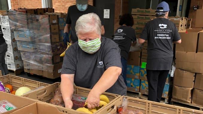 Loaves & Fishes volunteer Linda Jones helps package food boxes at Eastern Hills Baptist Church in Charlotte in July.