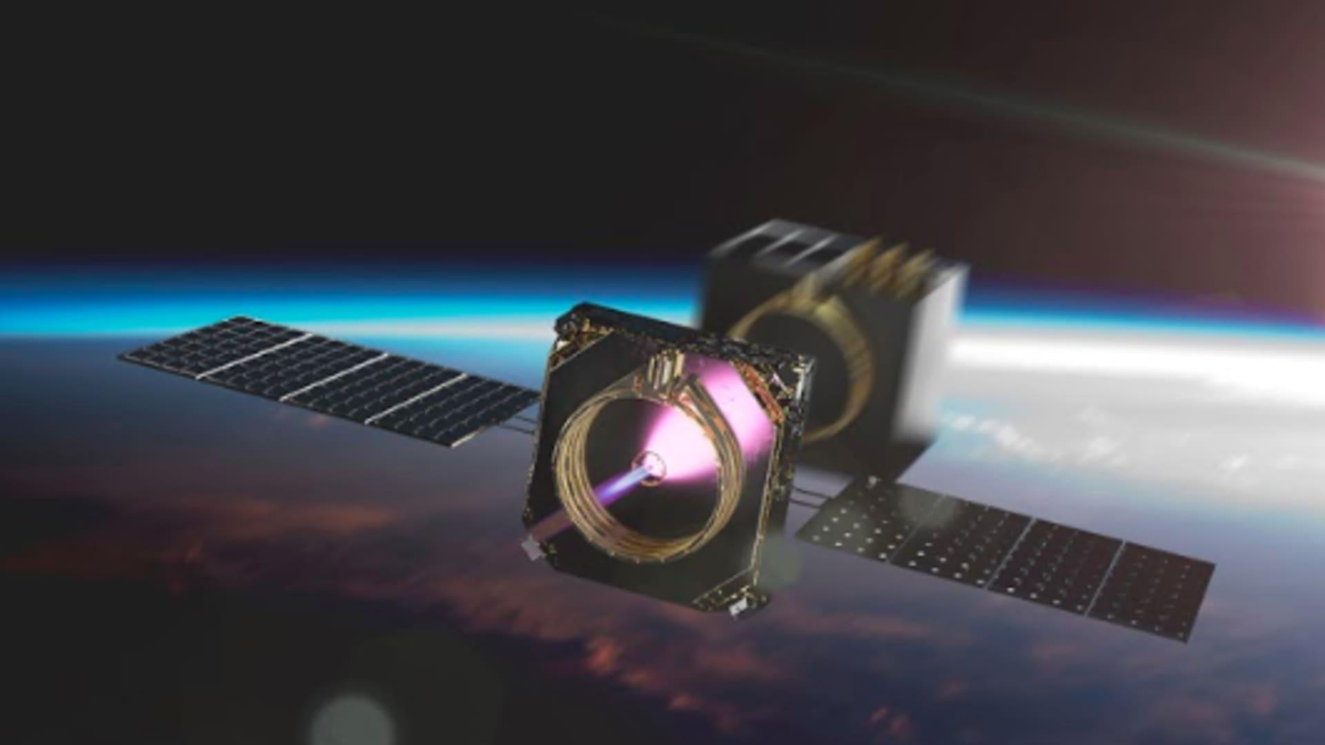 An artist's rendering of a Momentus Vigoride transfer vehicle deploying a satellite in orbit.