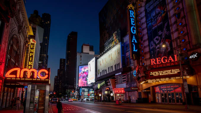 A Regal Cinemas movie theater stands at night on 42nd Street in New York, U.S., on Tuesday, Oct. 6, 2020.