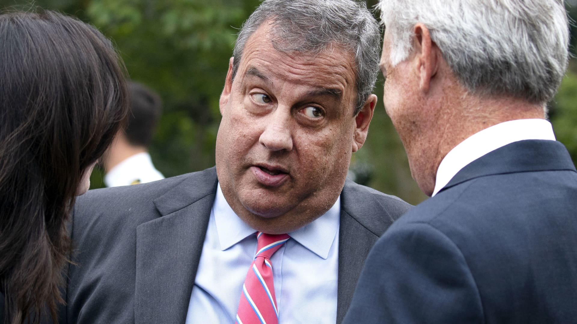 Chris Christie, former Governor of New Jersey, center, speaks with attendees following the announcement of U.S. President Donald Trump's nominee for associate justice of the U.S. Supreme Court during a ceremony in the Rose Garden of the White House in Washington, D.C., on Saturday, Sept. 26, 2020.