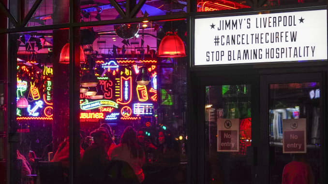 "As revelers enjoy their last night a sign supports canceling the curfew in the city center as tomorrow the ""very high"" risk lockdown regulations come into effect on October 13, 2020 in Liverpool, England."