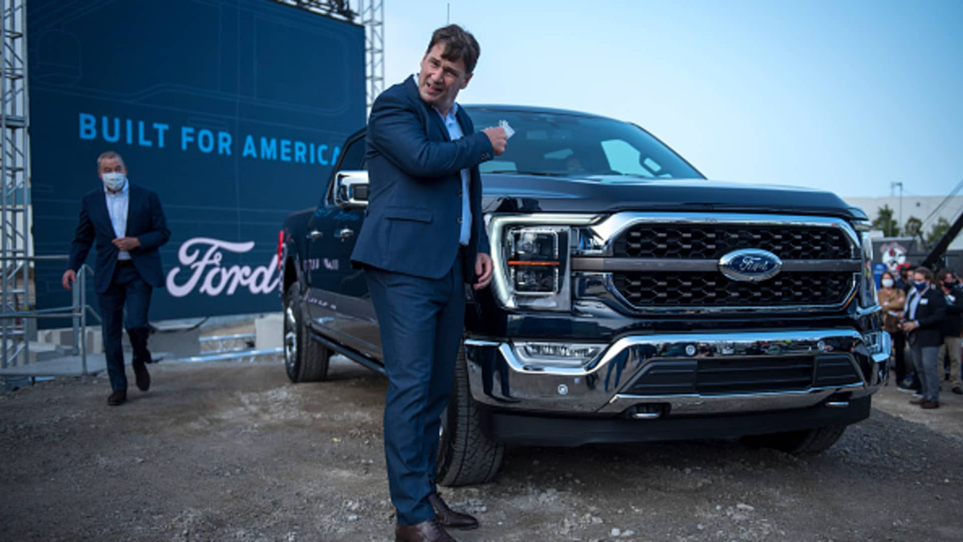 Ford CEO Jim Farley takes off his mask at the Ford Built for America event at Fords Dearborn Truck Plant on September 17, 2020 in Dearborn, Michigan.