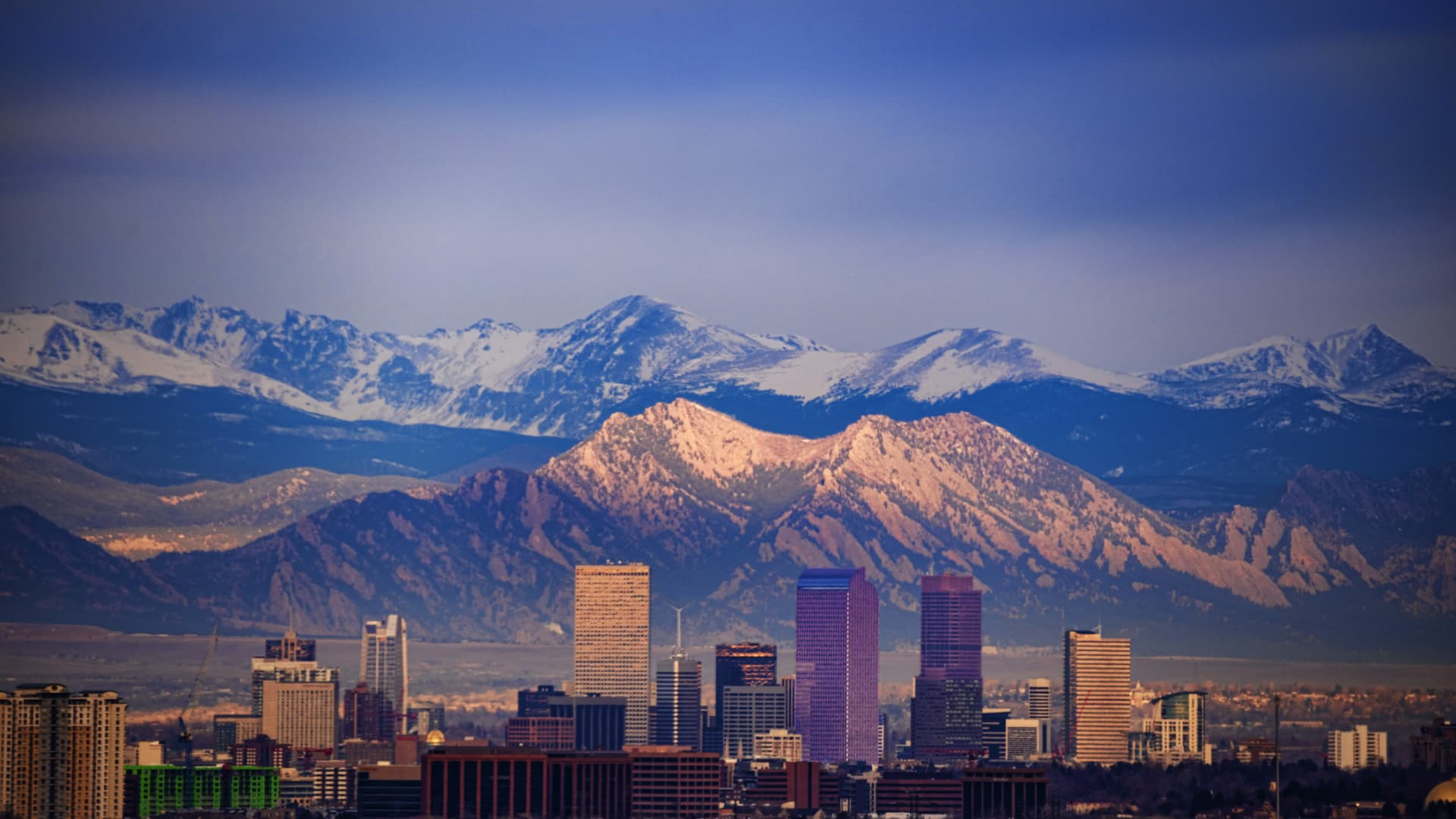 Downtown Denver, the Flatirons and Longs Peak in Colorado.