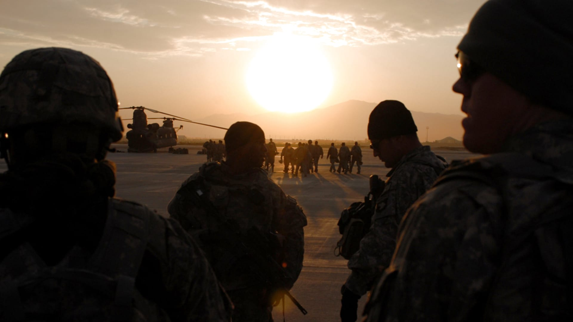 Soldiers from A Co., 101st Division Special Troop Battalion prepare to board a Chinook for an air assault mission Nov. 1, 2005 at Bagram Air Field, Afghanistan.