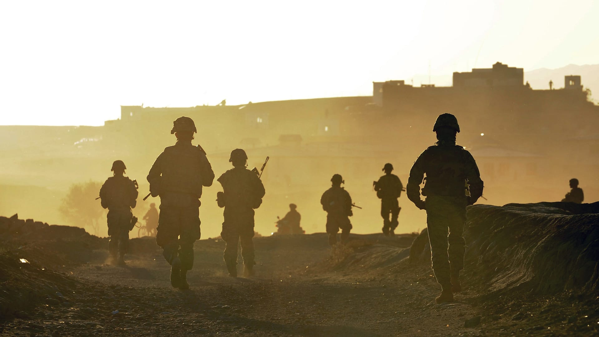U.S. Soldiers and Airmen from Provincial Reconstruction Team Zabul return to base after a quality assurance, quality control patrol near the city of Qalat, Zabul province, Afghanistan, Nov. 1, 2010.