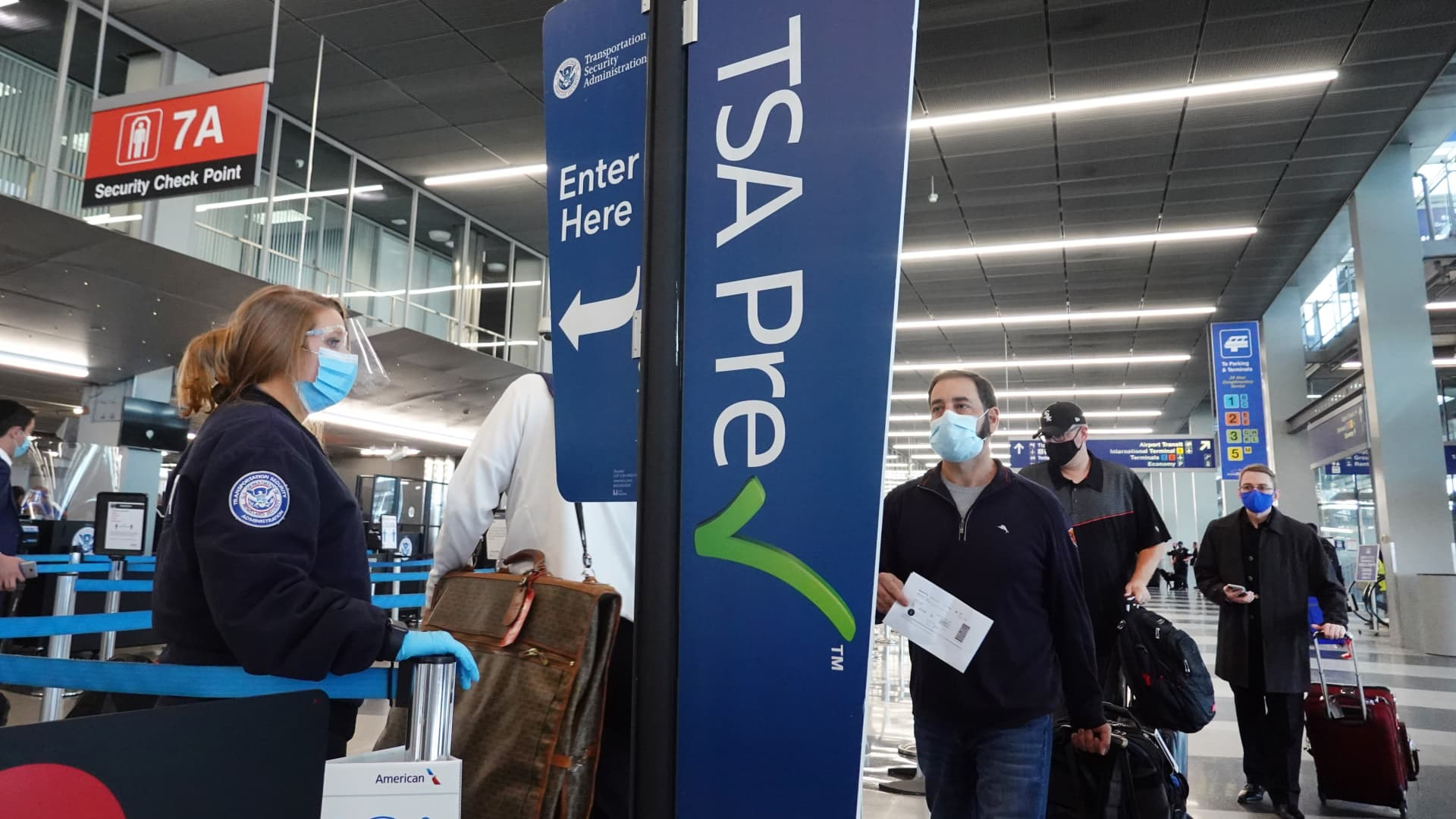 Passengers enter a Transportation Security Administration (TSA) checkpoint at O'Hare International Airport on October 19, 2020 in Chicago, Illinois.