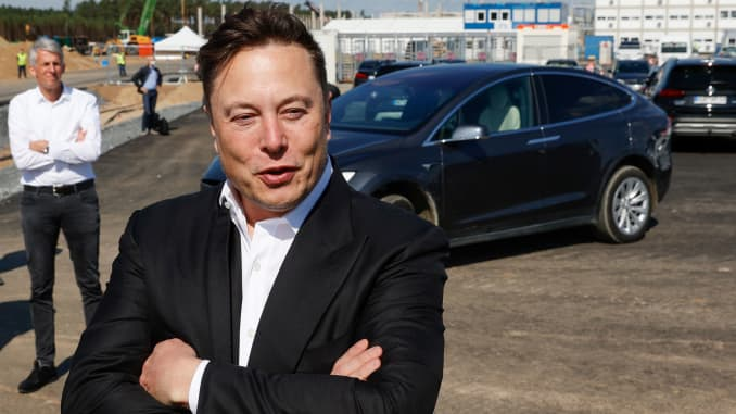 Tesla CEO Elon Musk talks to media as he arrives to visit the construction site of the future US electric car giant Tesla, on September 03, 2020 in Gruenheide near Berlin.