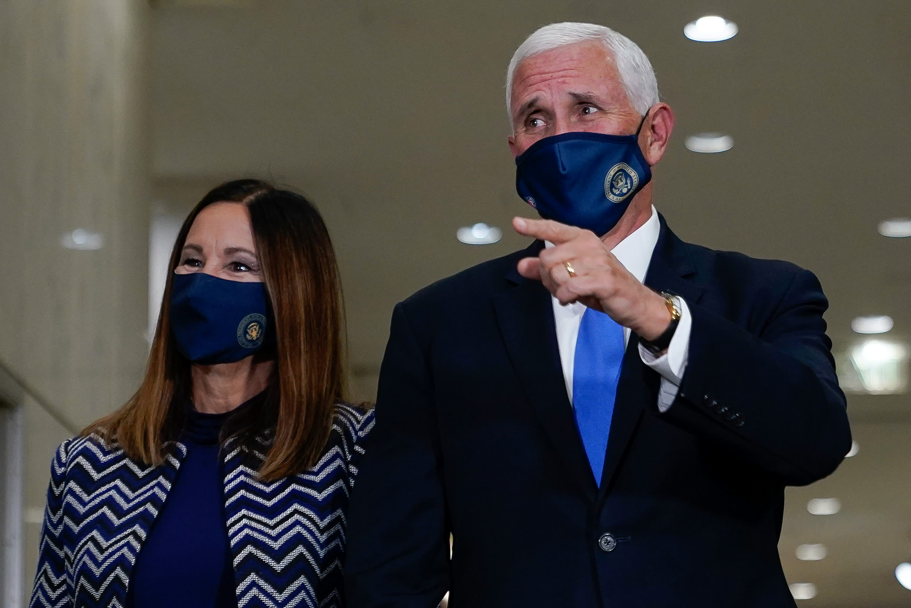 Mike Pence will not quarantine after four aides test positive for coronavirus