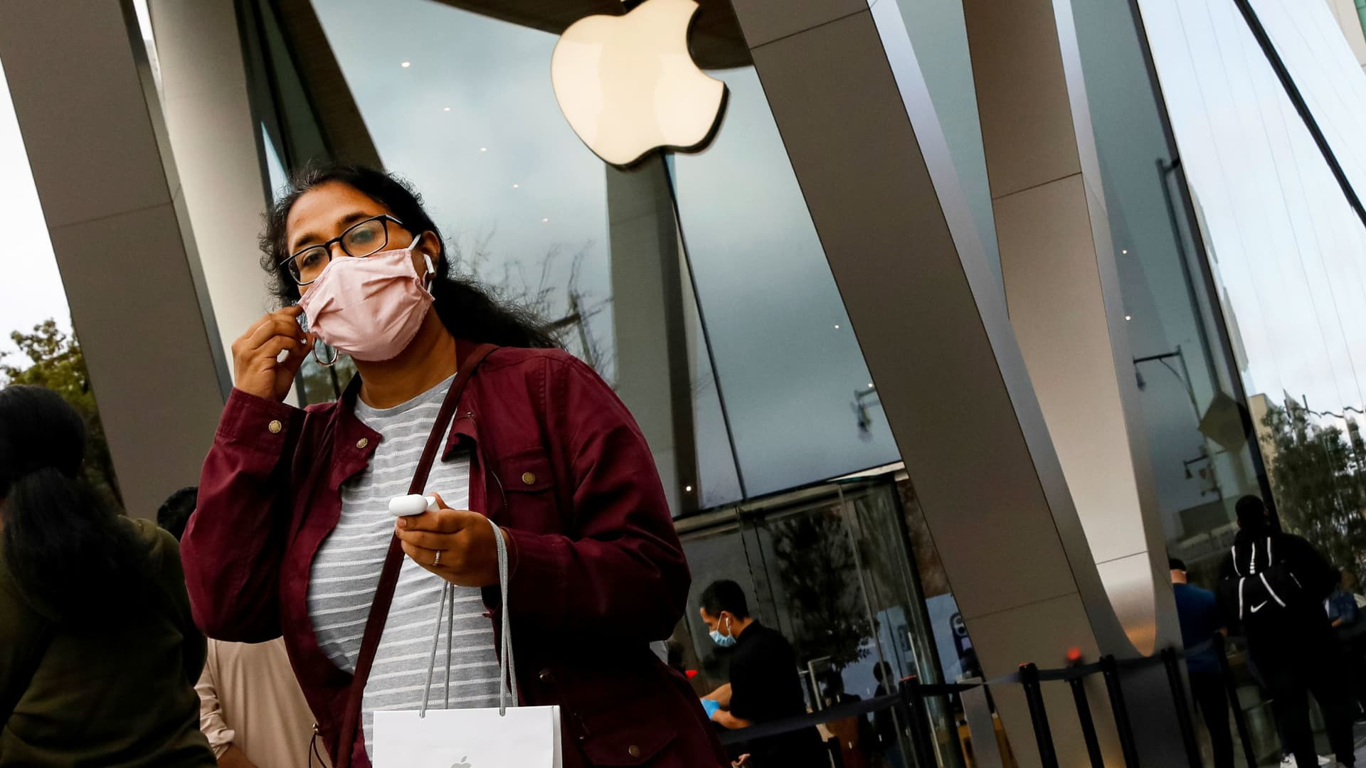 A customer exits after picking up Apple's new 5G iPhone 12 that went on sale, as the coronavirus disease (COVID-19) outbreak continues, at an Apple Store in Brooklyn, New York, October 23, 2020.