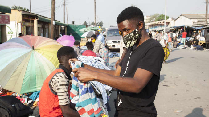 A man wearing a face mask selects clothes at a market in Lusaka, capital of Zambia, on Aug. 18, 2020. Zambia's confirmed COVID-19 cases have continued rising, with the total number close to the 10,000 mark.