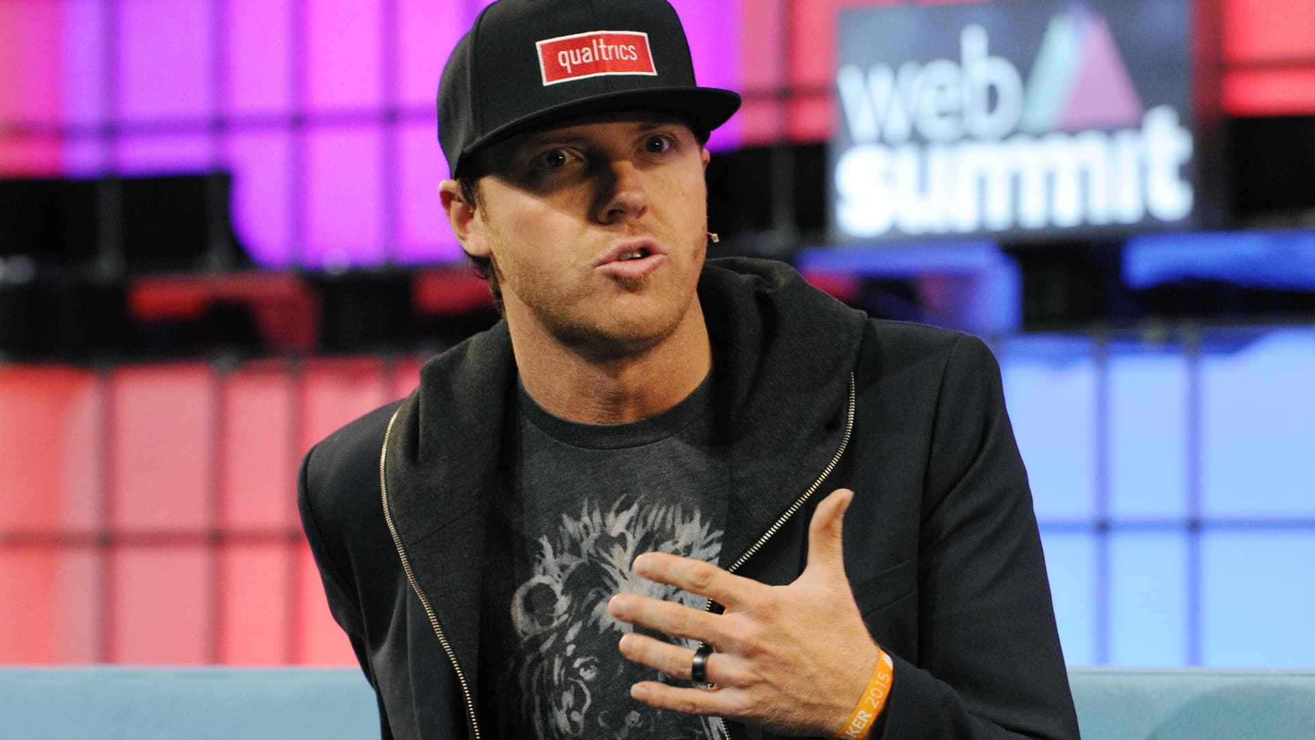 Ryan Smith, Chairman of Qualtrics peaks on stage during the 2015 Web Summit on in Dublin, Ireland.