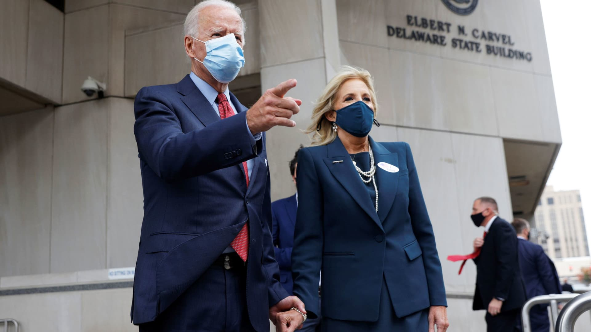 Democratic U.S. presidential nominee and former Vice President Joe Biden talks to reporters with his wife Jill at his side as they depart after casting their votes in the 2020 U.S. presidential election in Wilmington, Delaware, October 28, 2020.