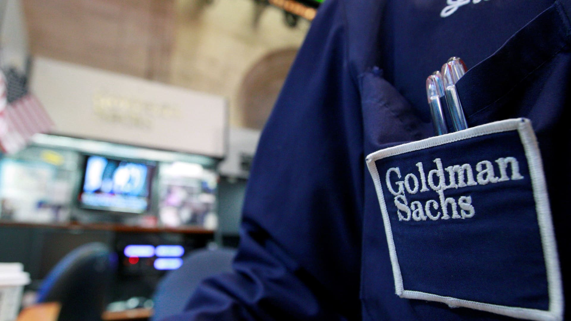 A trader works at the Goldman Sachs stall on the floor of the New York Stock Exchange.