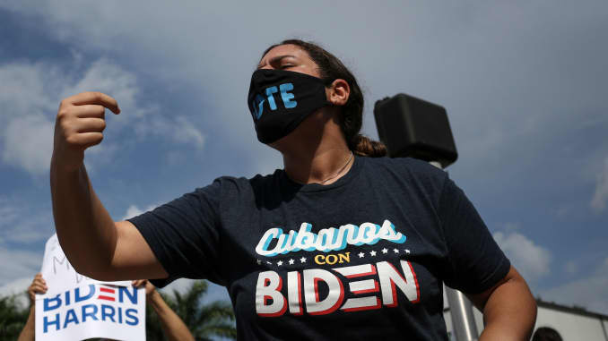 "A supporter of Democratic presidential candidate Joe Biden shouts as she attends a rally outside the ""Latinos for Trump Roundtable"" event in Doral, Florida, on September 25, 2020."
