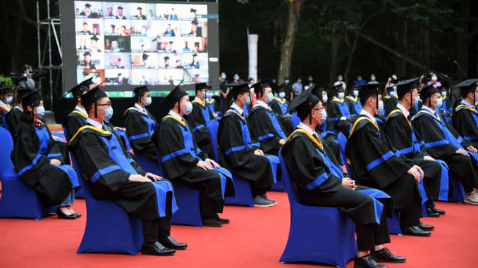Graduates attend the commencement ceremony at Beihang University in Beijing, capital of China, June 29, 2020.