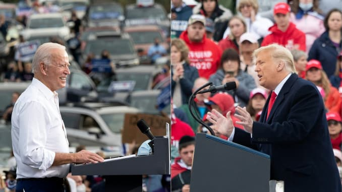 This combination of pictures created on October 30, 2020 shows Democratic Presidential Candidate Joe Biden speaks during a voter mobilization event in Atlanta, Georgia, on October 27, 2020 and US President Donald Trump holds a Make America Great Again cam