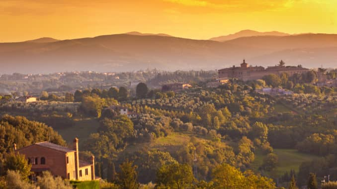 Sunset scene of the rural country villages of Siena, Italy.
