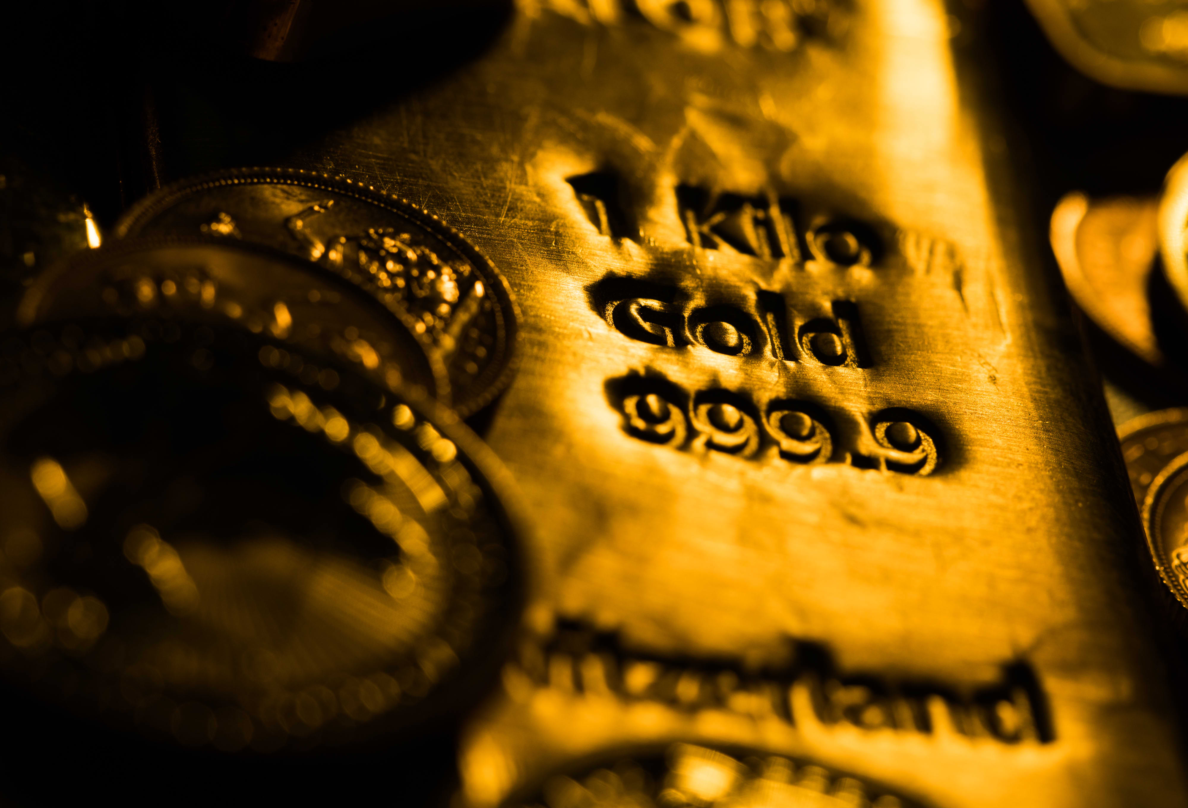Gold slumps to 9-month trough as yields, dollar rally continues - CNBC