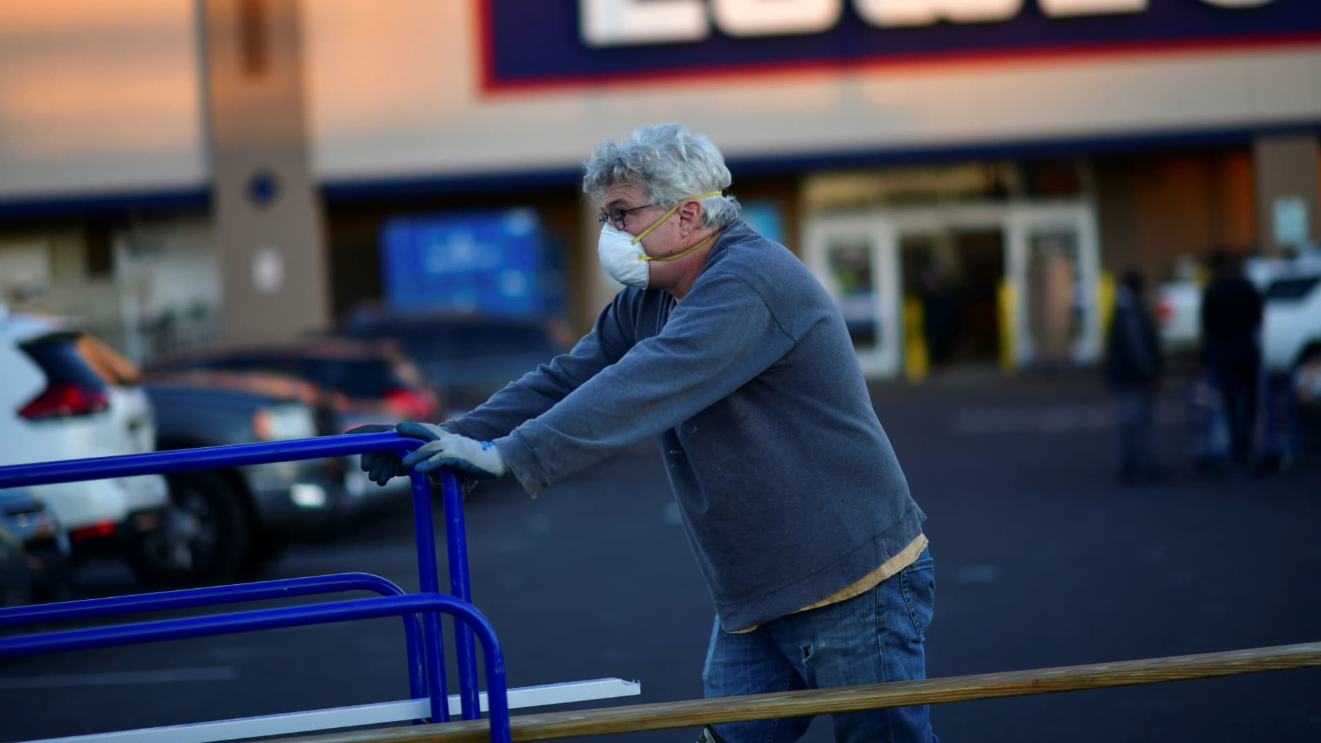 A shopper departs after visiting a Lowe's hardware store in Philadelphia, Pennsylvania, November 4, 2020.