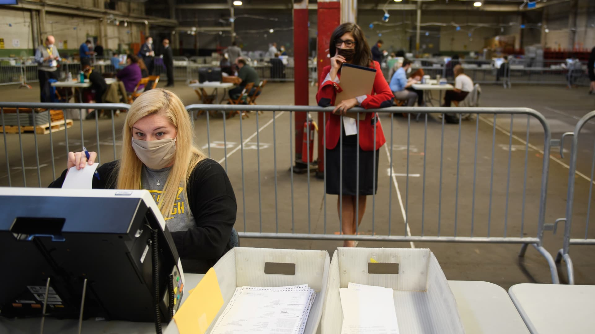A poll watcher monitors the counting of ballots at the Allegheny County elections warehouse on November 6, 2020 in Pittsburgh, Pennsylvania.