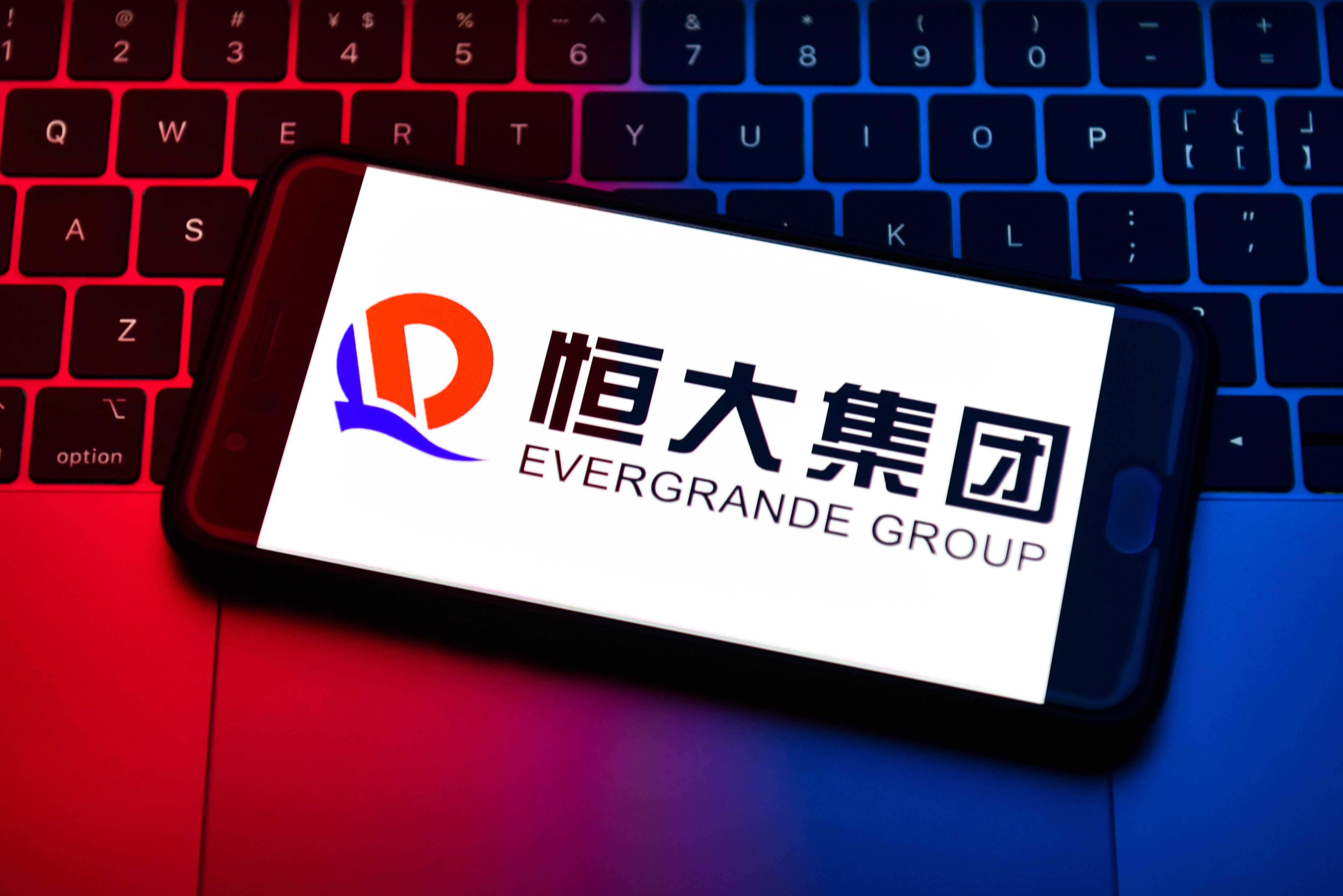 Evergrande Property shares fall on Hong Kong debut...