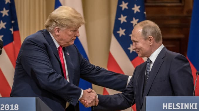 Good chemistry: President Donald Trump and Russian President Vladimir Putin shake hands during a joint press conference after their summit on July 16, 2018 in Helsinki, Finland.