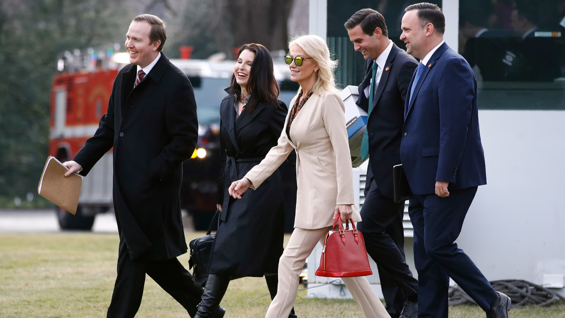 White House Political Director Brian Jack, from left, Deputy Staff Secretery Catherine Keller, Counselor to the President Kellyanne Conway, aide John McEntee and White House Social Media Director Dan Scavino walk across the South Lawn of the White House in Washington, Thursday, Jan. 23, 2020.