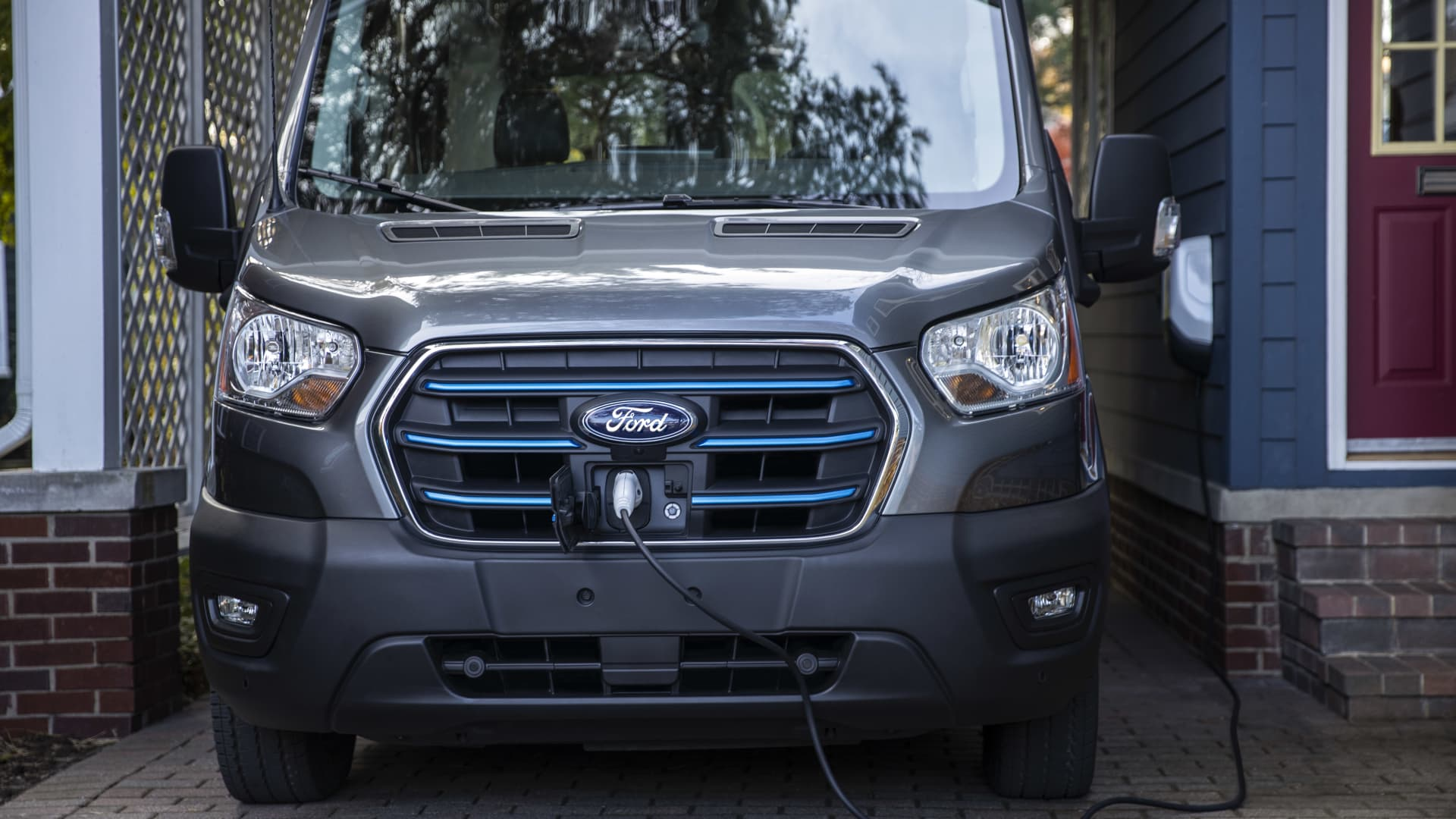 The charging port for the Ford E-Transit van is located in the vehicle's grille.