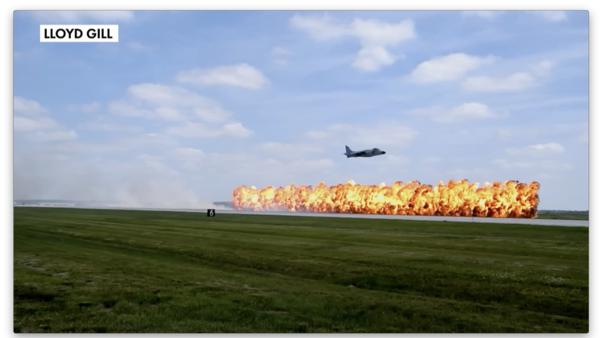 Retired Marine Lt. Col. Art Nalls flies his Harrier in an airshow with pyrotechnics.