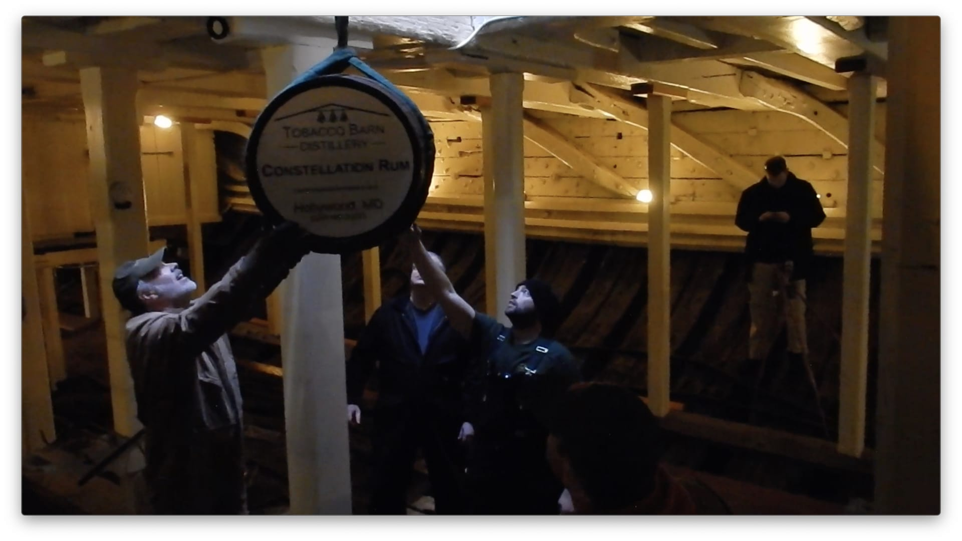 Barrels of rum are lowered into the USS Constellation in Baltimore Harbor.
