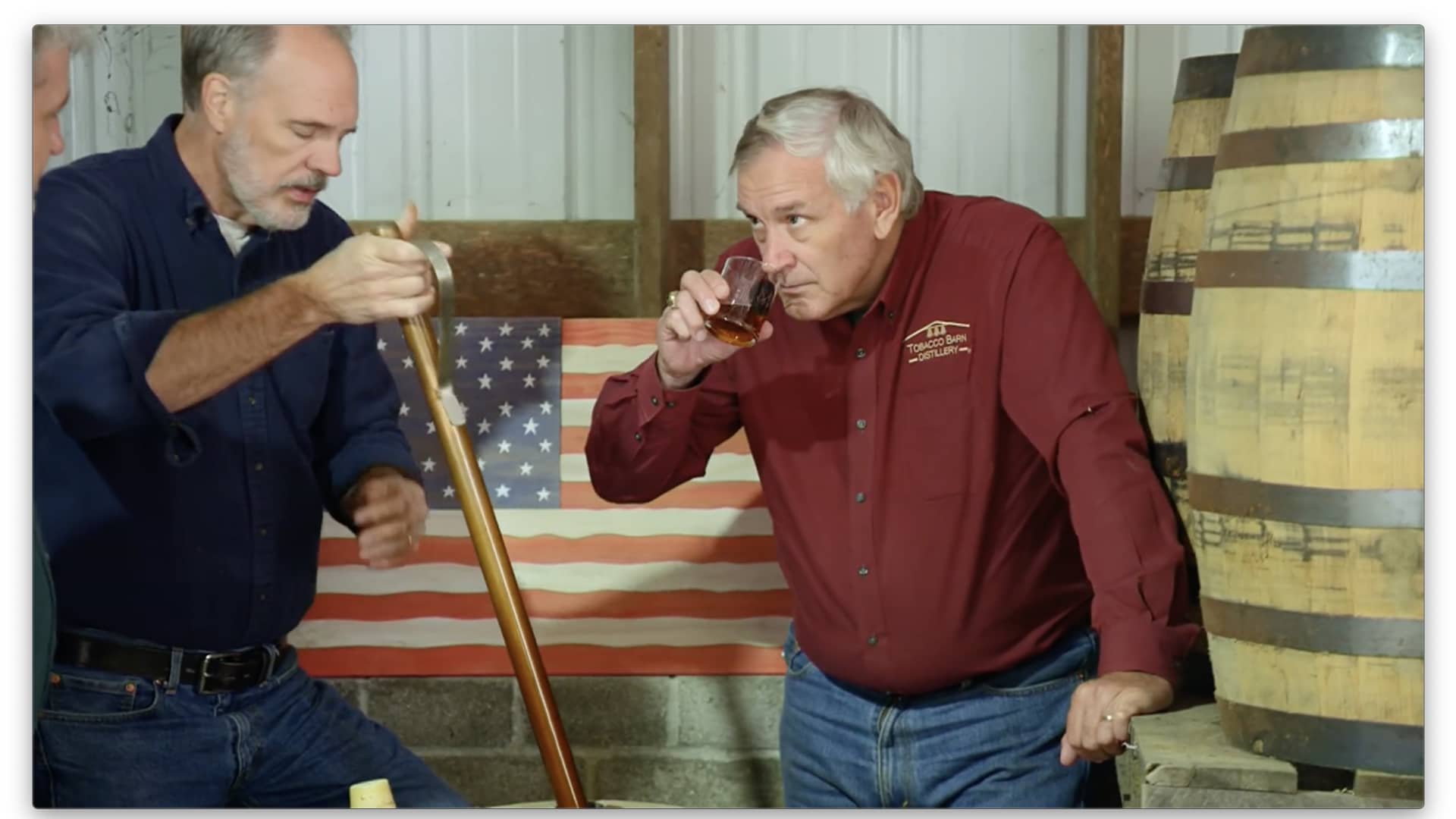 Retired Navy Rear Adm. Scott Sanders, right, and his business partners, Sean Coogan and Dan Dawson, from left, sample bourbon in the Tobacco Barn Distillery's rickhouse.