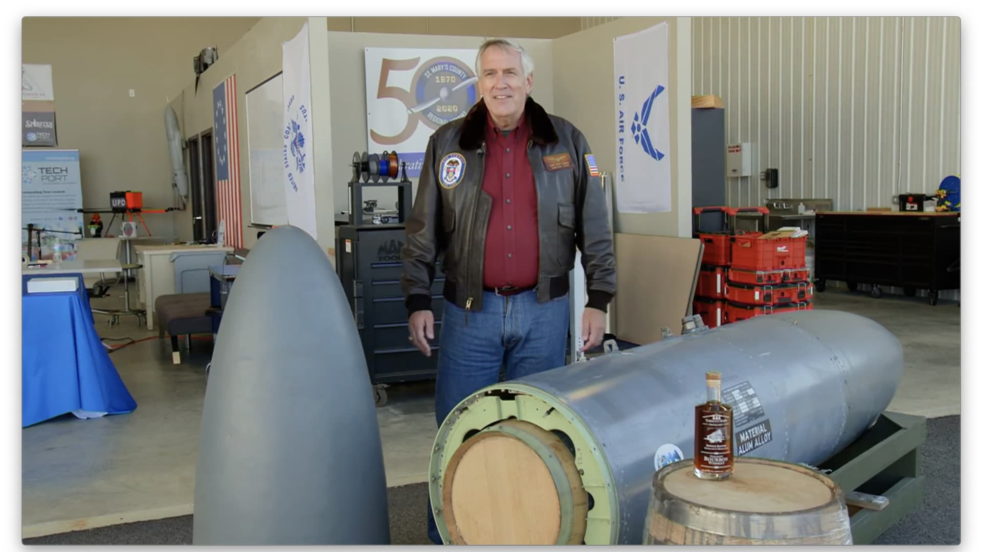 Retired Navy Rear Adm. Scott Sanders explains how the Harrier's reconfigured fuel tank can hold two 25-gallon barrels of bourbon.
