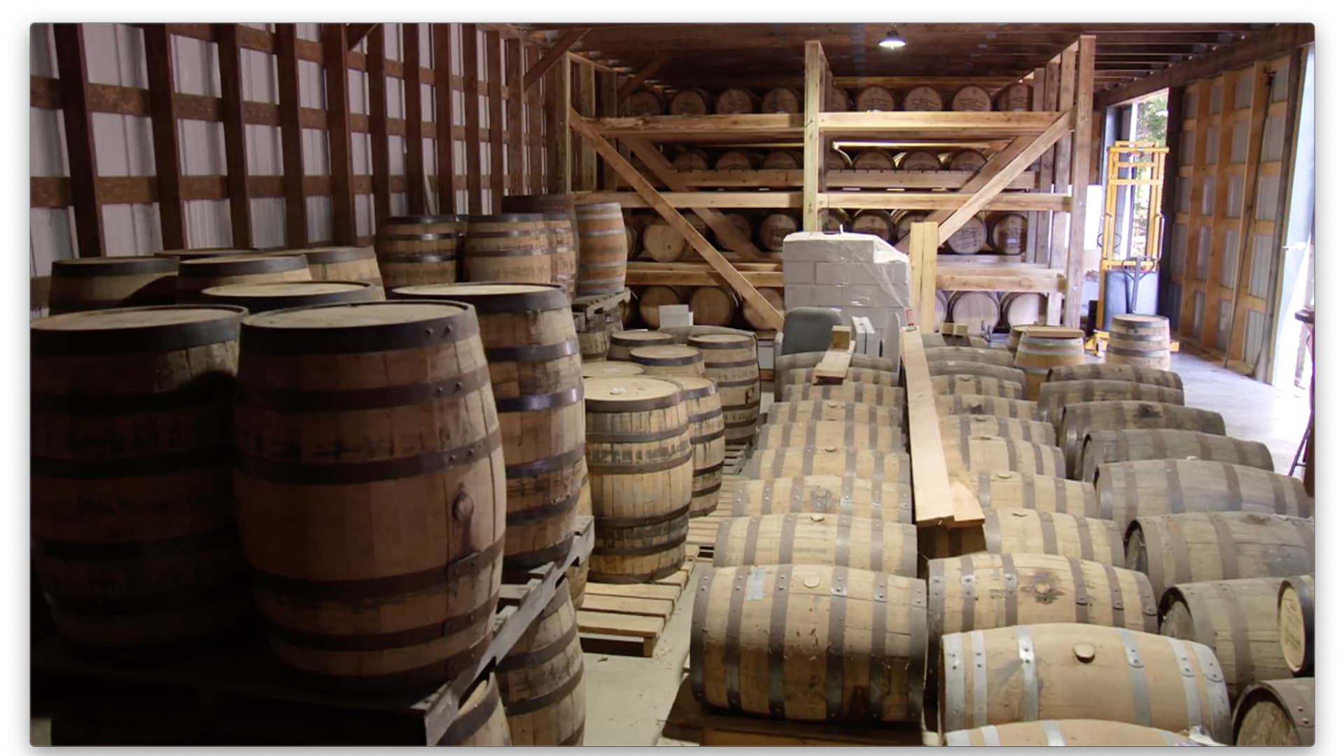Barrels of spirits age at the Tobacco Barn Distillery in Hollywood, Maryland.