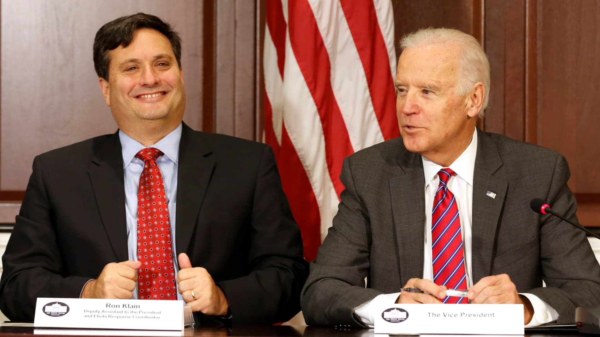 U.S. Vice President Joe Biden (R) is joined by Ebola Response Coordinator Ron Klain (L) in the Eisenhower Executive Office Building on the White House complex in Washington, U.S. November 13, 2014.