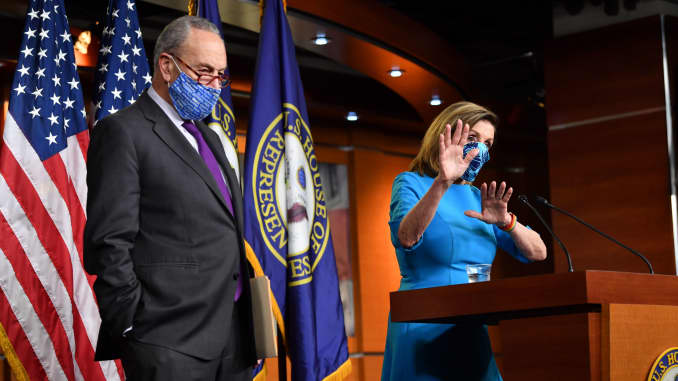 Speaker of the House Nancy Pelosi (R), D-Calif., and Senate Minority Leader Chuck Schumer, D-N.Y., hold a press briefing on Capitol Hill on Nov. 6, 2020.