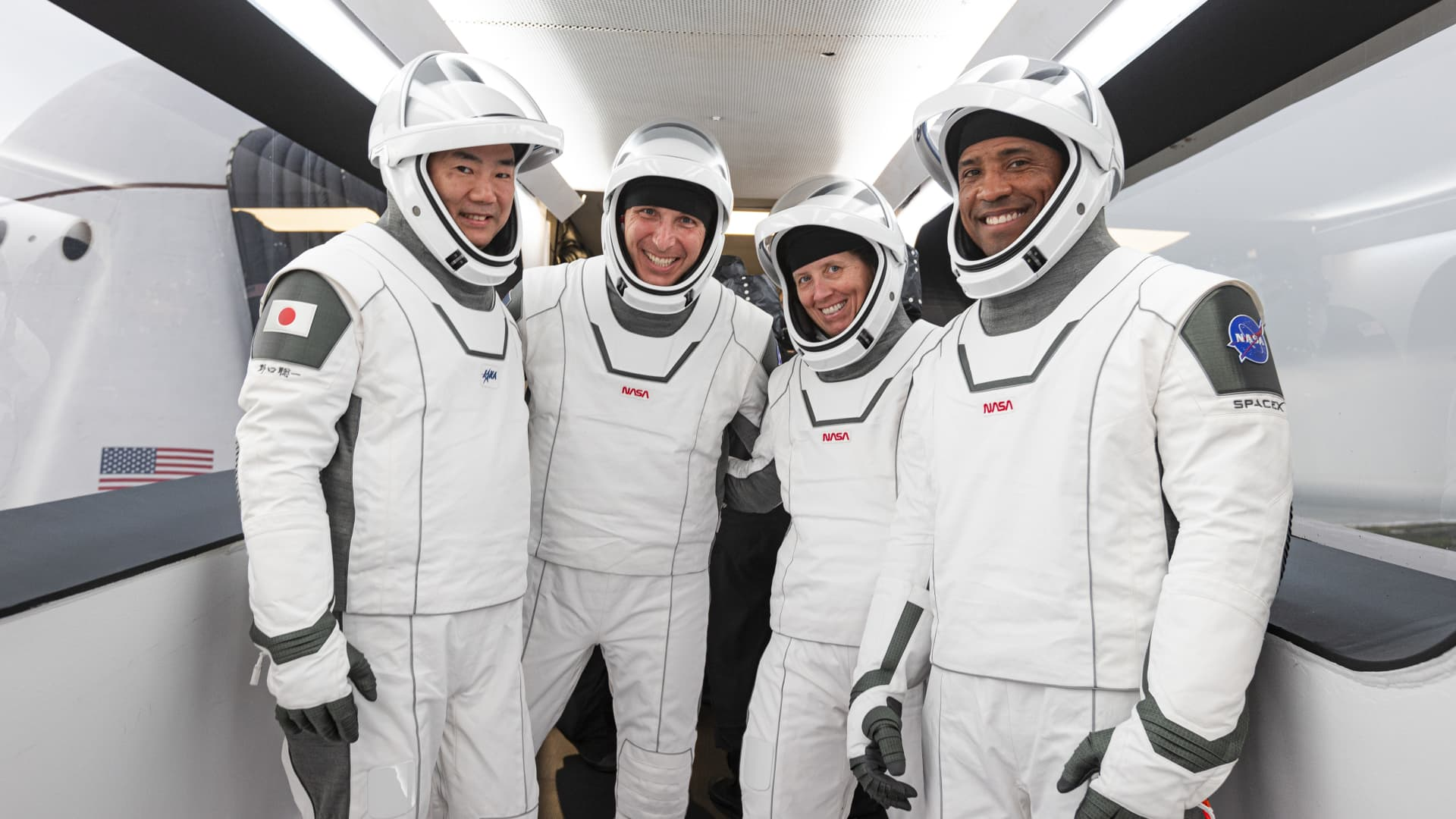 NASA astronauts (right to left) Victor Glover, Shannon Walker, Mike Hopkins and JAXA astronaut Soichi Noguchi in their SpaceX spacesuits during Crew-1 pre-launch preparations.
