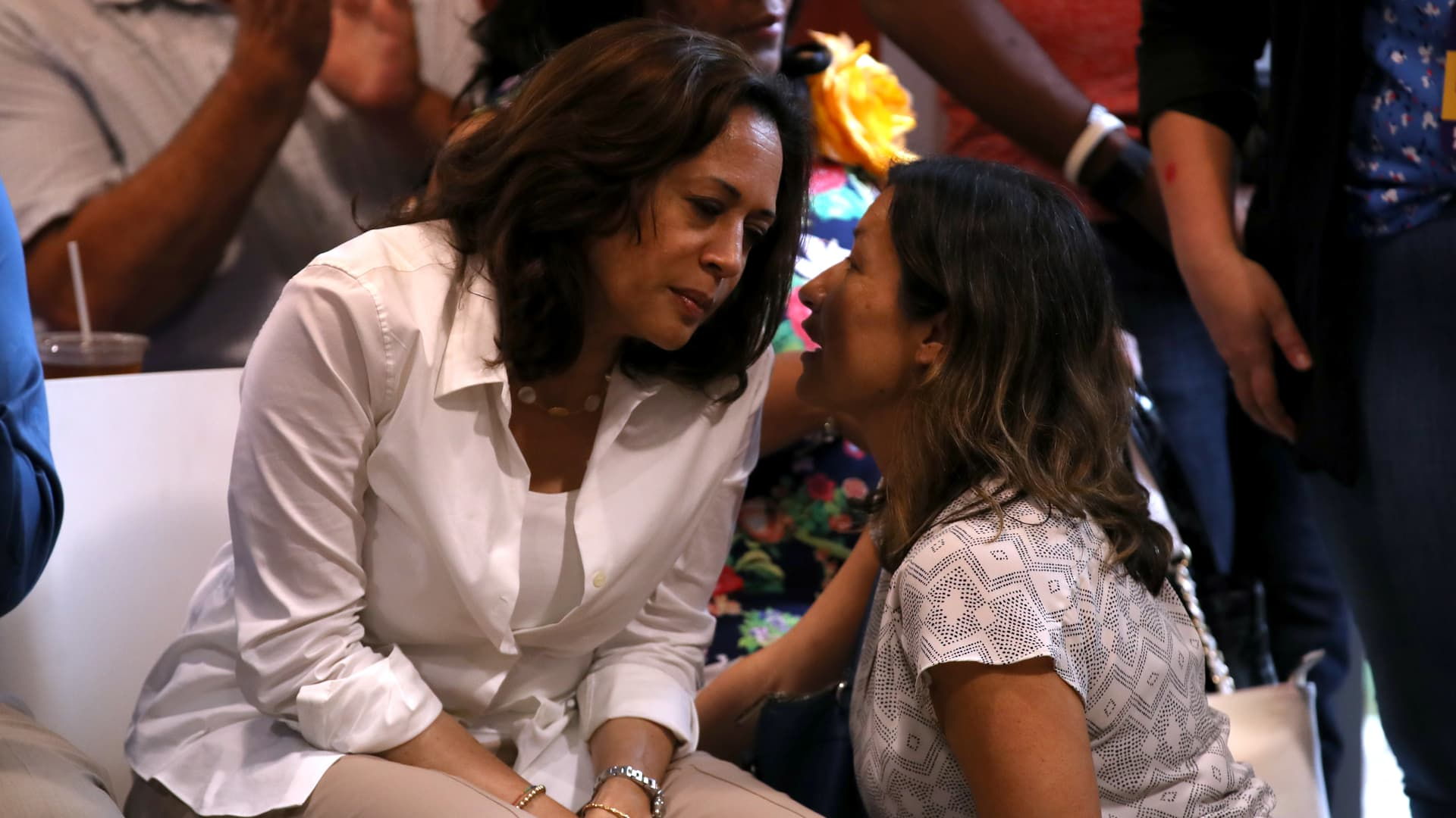 Democratic presidential hopeful U.S. Sen. Kamala Harris (L) (D-CA) talks with her aide Julie Chavez Rodriguez (R) during the Asian and Latino Coalition event at Jasper Winery on August 10, 2019 in Des Moines, Iowa.
