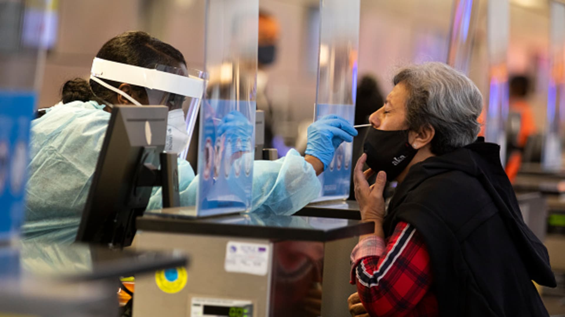 During the global coronavirus pandemic Ana Ramos, right, is being tested for covid19 in Tom Bradley international at LAX on Tuesday, Nov. 17, 2020 in Los Angeles, CA.