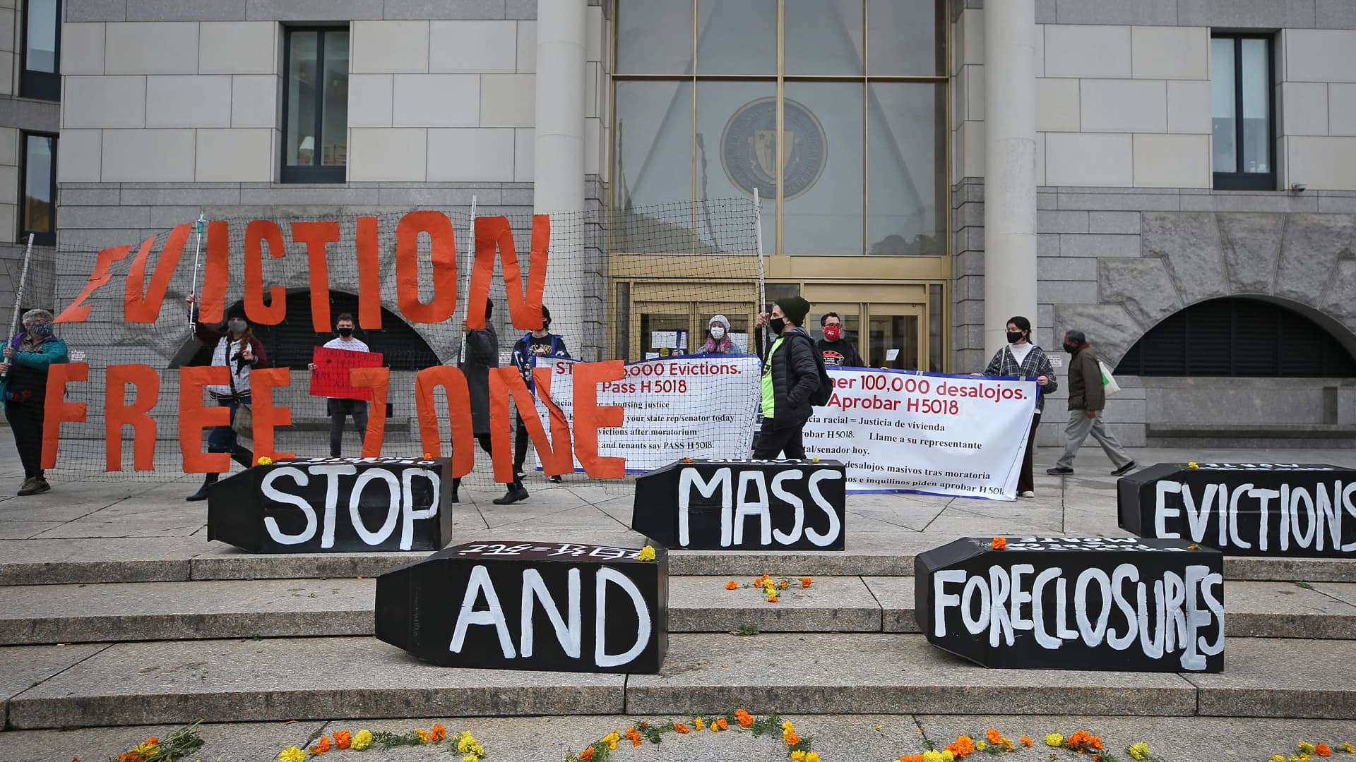 Demonstrators display signs calling for an end to evictions and foreclosures during a rally at Boston Housing Court outside the Edward W. Brooke Courthouse on Oct. 29, 2020.