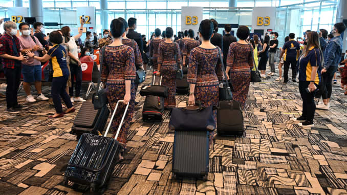 Singapore Airlines crew members at Changi International Airport in Singapore on Oct. 24, 2020.